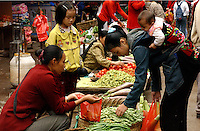 The outdoor vegetable and meat market in Jinghong, Yunnan. Jinghong is home to the Dai minority people.<br /> 01-NOV-02
