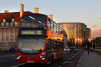 London double deck bus passing through Westminster Bridge at sunset, London, UK. Picture by Manuel Cohen