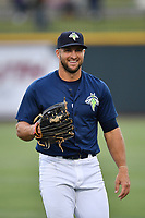 Left fielder Tim Tebow (15) of the Columbia Fireflies warms up before a game against the Lakewood BlueClaws on Saturday, May 6, 2017, at Spirit Communications Park in Columbia, South Carolina. Lakewood won, 1-0 with a no-hitter. (Tom Priddy/Four Seam Images)