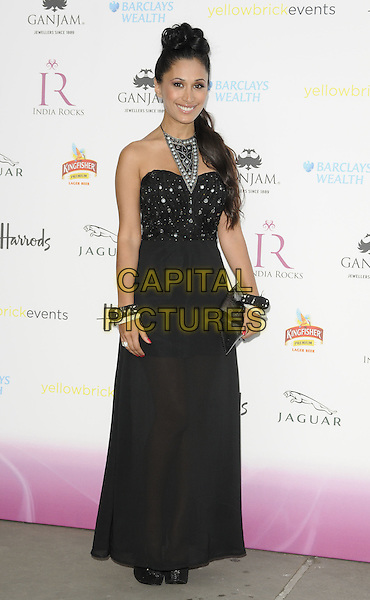 Preeya Kalidas.The India Rocks fundraiser party, Natural History Museum, London, England..June 27th, 2011.full length black maxi dress strapless clutch bag necklace .CAP/CAN.©Can Nguyen/Capital Pictures.