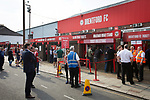 Home supporters gathering at the main entrance to the stadium on Braemar Road pictured before Brentford hosted Leeds United in an EFL Championship match at Griffin Park. Formed in 1889, Brentford have played their home games at Griffin Park since 1904, but are moving to a new purpose-built stadium nearby. The home team won this match by 2-0 watched by a crowd of 11,580.