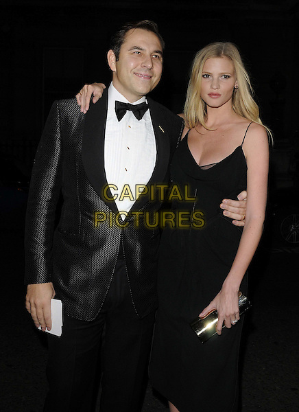 David Walliams & Lara Stone .The George Michael special concert, Royal Opera House, Covent Garden, London, England..November 6th, 2011.half length black  dress tuxedo white shirt bow tie arm around waist married husband wife.CAP/CAN.©Can Nguyen/Capital Pictures.