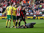 Angus Gunn and Christoph Zimmermann of Norwich City in action with David Brooks of Sheffield Utd during the Championship match at Bramall Lane Stadium, Sheffield. Picture date 16th September 2017. Picture credit should read: Jamie Tyerman/Sportimage