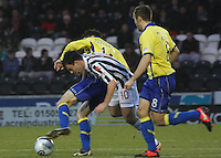 Paul Heffernan tackles Paul McGowan in the St Mirren v Kilmarnock Clydesdale Bank Scottish Premier League match played at St Mirren Park, Paisley on 2.1.13.