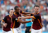 Calcio, Serie A: Roma vs Juventus. Roma, stadio Olimpico, 30 agosto 2015.<br /> Roma&rsquo;s Miralem Pjanic, right, celebrates with teammate Seydou Keita after scoring during the Italian Serie A football match between Roma and Juventus at Rome's Olympic stadium, 30 August 2015.<br /> UPDATE IMAGES PRESS/Riccardo De Luca