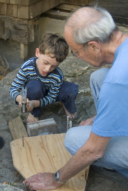 Berkeley CA Grandfather, seventy-five, helping grandson, five with power tools and carpentry project  MR