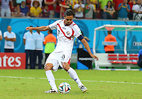 Bryan Ruiz of Costa Rica scores his penalty in the shootout