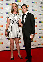 Peter Carter, Executive Vice President, Chief Legal Officer and Corporate Secretary, Delta Airlines and Teresa Carter arrive for the formal Artist's Dinner honoring the recipients of the 40th Annual Kennedy Center Honors hosted by United States Secretary of State Rex Tillerson at the US Department of State in Washington, D.C. on Saturday, December 2, 2017. The 2017 honorees are: American dancer and choreographer Carmen de Lavallade; Cuban American singer-songwriter and actress Gloria Estefan; American hip hop artist and entertainment icon LL COOL J; American television writer and producer Norman Lear; and American musician and record producer Lionel Richie.  <br /> Credit: Ron Sachs / Pool via CNP /MediaPunch