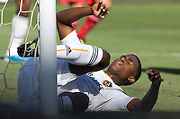 Edson Buddle of the LA Galaxy slides into the goalpost. The Chicago Fire beat the LA Galaxy 3-2 at Home Depot Center stadium in Carson, California on Sunday August 1, 2010.