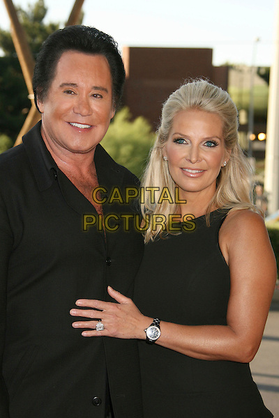 "WAYNE NEWTON & KATHLEEN (WIFE).2007 CineVegas Film Festival ""Ocean's 13"" Premiere held at Palms Casino Resort, Las Vegas, Nevada, USA..June 6th, 2007.half length black dress jacket hand on chest stomach ring diamond watch married husband.CAP/ADM/RE.©Russ Elliot/AdMedia/Capital Pictures"