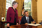 United States President Barack Obama signs the Southwest Border Security Bill in the Oval Office of the White House as U.S. Secretary of Homeland Security Janet Napolitano looks on, Washington, DC Friday, August 13, 2010..Credit: Martin H. Simon - Pool via CNP