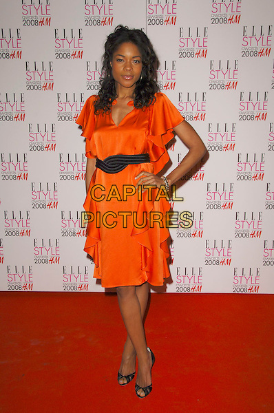NAOMIE HARRIS.ELLE Style Awards 2008, The Westway, London, England..February 12th, 2008.full length orange dress ruffles frills hand on hip black belt .CAP/CAS.©Bob Cass/Capital Pictures.