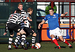 Andy Little takes on three defenders