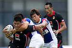 The China team in action during Day 2 of the Shanghai Sevens - part of the HSBC Asian Sevens Series - at the Yuanshen Stadium on August 28, 2011 in Shanghai, China. Photo  © Raf Sanchez / The Power of Sport Images for Societe Generale