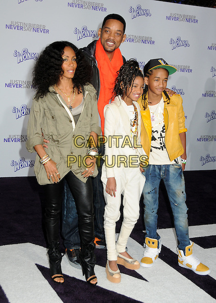 "JADA PINKETT SMITH, WILL SMITH, WILLOW SMITH & JADEN SMITH.""Justin Bieber: Never Say Never"" Los Angeles Premiere held at Nokia Theater L.A. Live, Los Angeles, California, USA..February 8th, 2011.full length sister brother siblings family yellow leather jacket cap hat jeans cream white jeans trousers mother father dad mum parents arms around green khaki coat parker parker trainers shoes platform married husband wife .CAP/ADM/BP.©Byron Purvis/AdMedia/Capital Pictures."