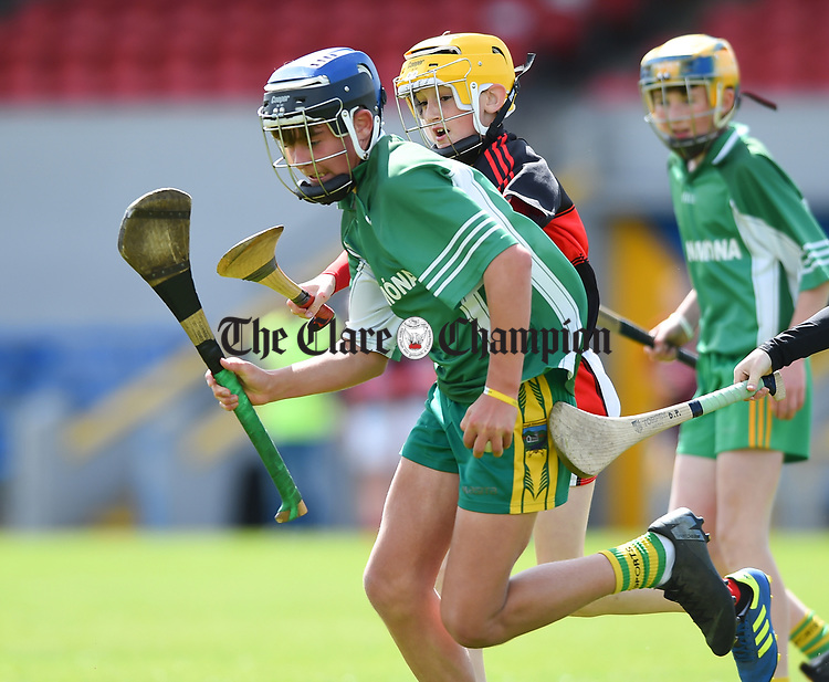 James Hegarty of Kilnamona in action against Jake Gibbons of Mountshannon/Lackyle during their Schools Division 3 final at Cusack Park. Photograph by John Kelly