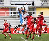 Daniel Stanese (5) of Canada collides with Ivan Picart (1) of Panama as he goes up to punch the ball during the semifinals of the CONCACAF Men's Under 17 Championship at Catherine Hall Stadium in Montego Bay, Jamaica. Canada defeated Panama, 1-0.