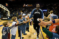 Nazr Mohammed greets young fans during an NBA basketball game Time Warner Cable Arena in Charlotte, NC.
