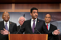 United States Representative Ro Khanna (Democrat of California) makes remarks at a press conference in the US Capitol in Washington, DC announcing a Democratic package of three bills to be introduced in the US Senate and US House to control prescription drug prices on Thursday, January 10, 2019. Standing behind Representative Khanna, from left to right: US Representative Elijah Cummings (Democrat of Maryland), US Senator Bernie Sanders (Independent of Vermont), and US Senator Cory Booker (Democrat of New Jersey).<br /> Credit: Ron Sachs / CNP /MediaPunch