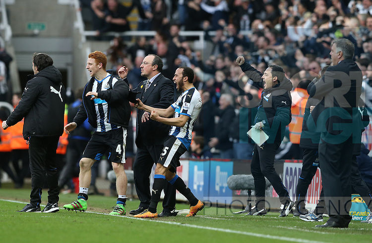 Newcastle United's manager Rafael Benitez, center, celebrates Aleksandar Mitrovic's goal during the Barclays Premier League match at St James' Park Stadium. Photo credit should read: Scott Heppell/Sportimage