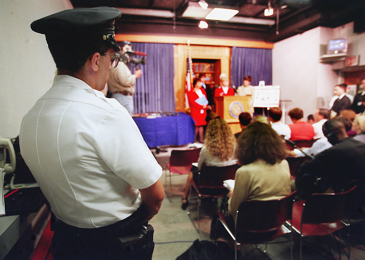 6-16-99.GUN SHOW LOOPHOLE AMENDMENT--J.P. Carlton a U.S. Capitol Policemen stands guard during a press conference on the gun show loophole admendment in the House Radio and T. V. Gallery. He was there because of the guns being used as props..CONGRESSIONAL QUARTERLY PHOTO BY DOUGLAS GRAHAM
