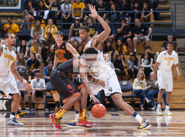 California's Richard Solomon defending during a game against USC at Haas Pavilion in Berkeley, California on February 23th, 2014. California defeated USC 77 - 64