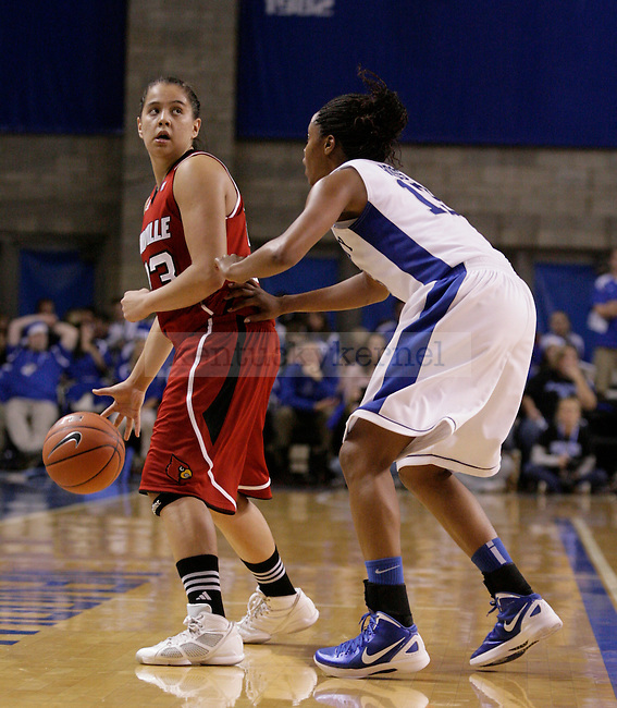 UK guard Bria Goss guards Shoni Shimmel of Louisville during the first half of the UK Women's basketball game against Louisville on 12/4/11 in Lexington, Ky. Photo by Quianna Lige | Staff
