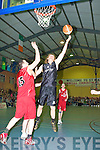 Andrew Fitzgerald St Pauls Maurice Casey St Mary's in action during the Division 1 Mens Final at the St Mary's basketball blitz in Castleisland Community Centre on Tuesday
