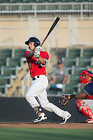 Seby Zavala (21) of the Kannapolis Intimidators follows through on his swing against the Lakewood BlueClaws at Kannapolis Intimidators Stadium on August 11, 2016 in Kannapolis, North Carolina.  The Intimidators defeated the BlueClaws 3-1.  (Brian Westerholt/Four Seam Images)