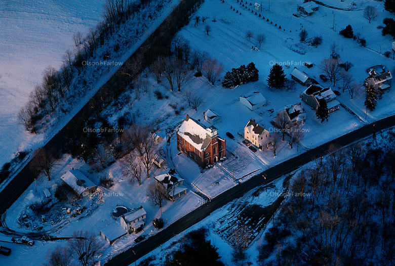 Aerial view shows the old National Road that goes through town lined by the church and houses.  The larger road on the top is the new road that bypasses the main street.<br /> Centerville was named because it was halfway along the National Road between Uniontown and Washington, PA.