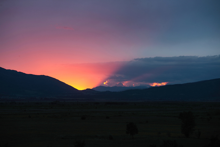 Sunset in the northern part of Livansko Polje field -  karst plateau (arguably the largest karst field in the world) with the Dinara mountain range (on the left). Zdralovac area in the foreground. This is an area that was affected by Balkan war (1991-1995) and now is plenty of mine fields. May 2009. <br /> Bosnia-Herzegovina.