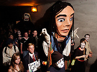 Participants walk in the All Souls' Procession in the Fourth Avenue underpass Sunday night. About 3000 people took park in the procession.