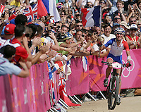11.08.2012. Hadleigh Woods, Essex, England.  Julie Bresset of France celebrates during the Women's Cross-country Final of the Cycling Mountain Bike event in Hadleigh Farm at the London 2012 Olympic Games, London, Great Britain, 11 August 2012.