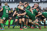 Chris Wyles of Saracens takes on the London Irish defence. Aviva Premiership match, between Saracens and London Irish on January 3, 2015 at Allianz Park in London, England. Photo by: Patrick Khachfe / JMP