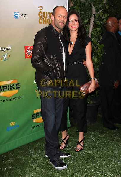 "JASON STATHAM & GIRLFRIEND .Spike TV's ""Guys Choice Awards"" held at Sony Studios, Culver City, California, USA, 30th May 2009..Full length black leather jacket jeans trainers couple sandals catsuit pantsuit .CAP/ADM/KB.©Kevan Brooks/Admedia/Capital Pictures"
