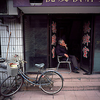 An elderly Chinese man smokes a cigarette at the old city area of Yangzhou, Jiangsu province, 2012. (Mamiya 6, 75mm, Kodak Ektar 100 film)