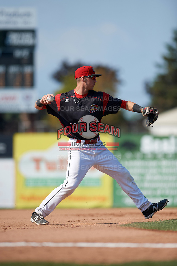 Batavia Muckdogs third baseman Tyler Curtis (11) throws to first base during the second game of a doubleheader against the Williamsport Crosscutters on August 20, 2017 at Dwyer Stadium in Batavia, New York.  Batavia defeated Williamsport 4-3.  (Mike Janes/Four Seam Images)