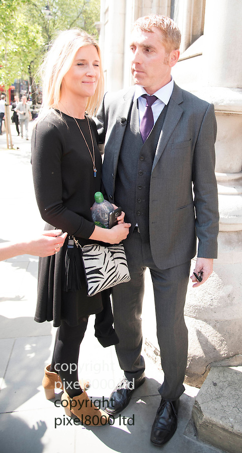 Pic shows: Jonathan Platt  outside the High Court in London today after winning his case again Isle of Wight council<br /> <br /> He left with fiancee Sally Barclay - blonde woman<br /> <br /> <br /> <br /> Pic by Gavin Rodgers/Pixel 8000 Ltd