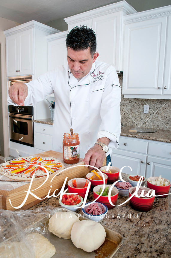 John Collura, Cibo e Vino creates two of his favorite pizza recipies in his home kitchen in Phoenix, Arizona. ©2014 Rick D'Elia/D'Elia Photographic