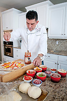 John Collura, Cibo e Vino creates two of his favorite pizza recipies in his home kitchen in Phoenix, Arizona. ©2014 Rick D'Elia/D'Elia Photographic