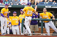 LSU Tigers outfielder Jake Fraley (23) is greeted by teammate Chris Chinea (26) after scoring against the TCU Horned Frogs in Game 10 of the NCAA College World Series on June 18, 2015 at TD Ameritrade Park in Omaha, Nebraska. TCU defeated the Tigers 8-4, eliminating LSU from the tournament. (Andrew Woolley/Four Seam Images)
