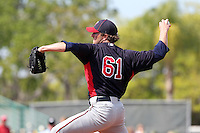 Minnesota Twins pitcher Jared Burton #61 delivers a pitch during a spring training game against the Pittsburgh Pirates at McKechnie Field on March 10, 2012 in Bradenton, Florida.  Minnesota defeated Pittsburgh 4-2.  (Mike Janes/Four Seam Images)