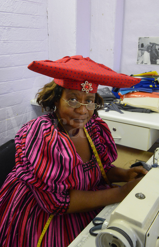 Windhoek Namibia Africa Herero tribe woman sewing fabrics and crafts at Penduka Craft Center for sale to tourists