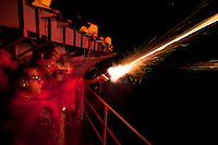 110101-N-7981E-052 PACIFIC OCEAN (Jan. 1, 2011)- Weapons Department Sailors ring in the new year at midnight with a qualification fire of pencil flares in the first time zone west of the International Date Line aboard the aircraft carrier USS Carl Vinson (CVN 70).  Carl Vinson and Carrier Air Wing (CVW) 17 are on a deployment to the U.S. 7th Fleet area of responsibility. (U.S. Navy photo by Mass Communication Specialist 2nd Class James R. Evans / RELEASED)