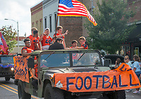 NWA Democrat-Gazette/BEN GOFF @NWABENGOFF<br /> The Rogers Heritage football team rides in the school's homecoming parade Friday, Oct. 5, 2018, through downtown Rogers. This year's parade had a 'Candyland' theme.