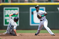 Dayton Dragons shortstop Hector Vargas (7) turns a double play as Josh Lester (32) of the West Michigan Whitecaps slides into second base at Fifth Third Field on May 29, 2017 in Dayton, Ohio.  The Dragons defeated the Whitecaps 4-2.  (Brian Westerholt/Four Seam Images)