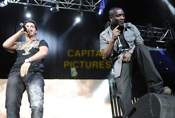COLBY O'DONIS & AKON .live at The102.7's KIIS-FM's Jingle Ball 08 held at The Honda Center in Anaheim, California, USA, .December 6th 2008                                                                     .music gig on stage half length grey gray shirt .CAP/DVS.©Debbie VanStory/Capital Pictures