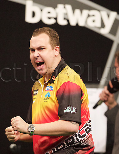 2.04.2015.  Manchester, England. Betway Premier League Darts. Judgement Night. Series debutant Kim Huybrechts celebrates a 180 score.
