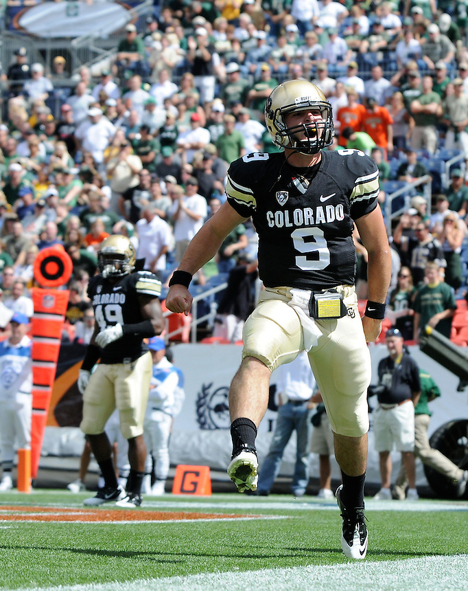 SEPTEMBER 17, 2011:   Colorado Buffaloes quarterback Tyler Hansen (9) celebrates a rushing touchdown   during an inter-conference game between the Colorado State Rams and the University of Colorado Buffaloes at Sports Authority Field at Mile High Field in Denver, Colorado. The Buffaloes led 14-7 at halftime*****For editorial use only*****