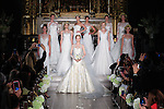 Models pose during finale for the Atelier Pronovias 2014 bridal runway show by Pronovias at St. James' Church in New York City, on November 12, 2013.